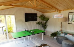 4.2 x 5.4m Burnham Studio at our Burford Show Site with games room interior and television