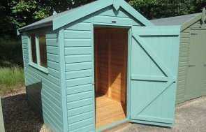 1.8 x 2.4m Classic Shed at our Nottingham Show Site with open door in the shade Mint