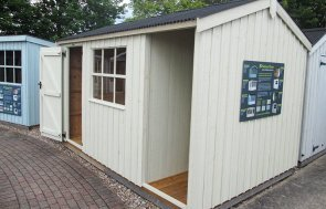 2.4 x 3.6m National Trust Blickling Garden Shed with log store at our Nottingham Show Site in shade Dome Ochre
