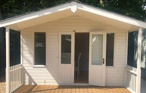 3.6 x 4.8m Morston Summerhouse at our Sunningdale Show Site with veranda and one door open
