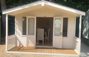 3.6 x 4.8m Morston Summerhouse at our Sunningdale Show Site with veranda and both doors open