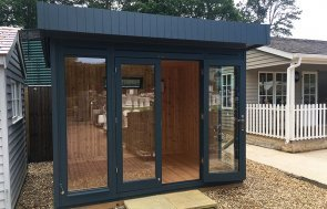 2.4 x 3.0m Salthouse Studio at our Sunningdale Show Site with one open door in the shade Slate from our exterior paint system
