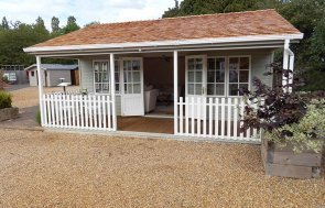 6.0 x 6.0m Pavilion Garden Room at our Burford Show Site in Farrow & Ball French Gray with shaded veranda