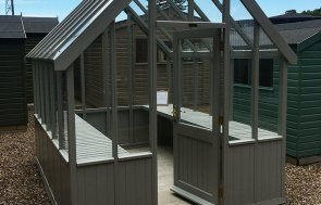 2.4 x 3.0m Greenhouse at our Sunningdale Show Site in the shade Pebble from our exterior paint system