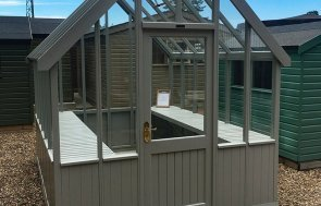 2.4 x 3.0m Greenhouse at our Sunningdale Show Site in the shade Pebble from our exterior paint system with workbench