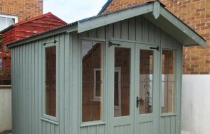 Stunning National Trust Ickworth summerhouse in Terrace Green with leaded windows and vertical sawn boards