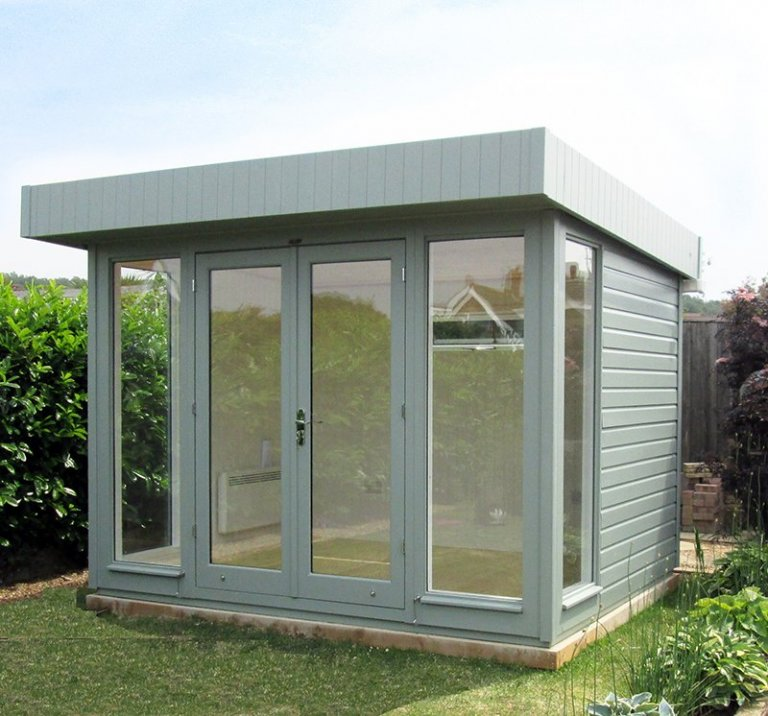 Modern Salthouse office studio in Sage from our exterior paint system with overhanging pent roof