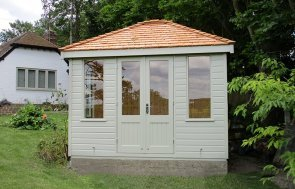 Cley Summerhouse with a Hipped Roof covered in Cedar Shingles