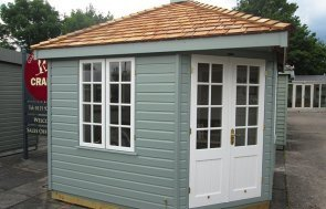 3.0 x 3.0m Weybourne Summerhouse at our Nottingham Show Site in the shade Sage from our exterior paint system