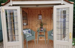 Inside the 1.8 x 2.5m Wiveton Summerhouse at our Newbury Show Site in the shade Taupe from our exterior paint system