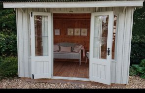 1.8 x 3.0m Flatford National Trust Summerhouse at our Newbury Show Site in Berkshire in the colour Disraeli Green