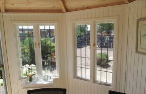 Inside the 3.0 x 3.0m Wiveton Summerhouse in Farrow & Ball Old White at our Nottingham Show Site
