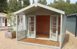 3.0 x 3.6m Morston Summerhouse at our Burford Show Site in the colour Lizard with the double doors open
