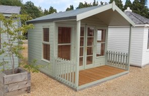 A side view of the 3.0 x 3.6m Morston Summerhouse with Veranda at our Burford Show Site in the colour Lizard