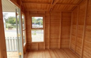 Inside the 3.0 x 3.6m Morston Summerhouse with Veranda at our Burford Show Site in the colour Lizard
