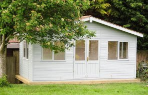 A large Binham Garden Studio with cedar shingle roof tiles and Pebble Paint from our Exterior Paint System