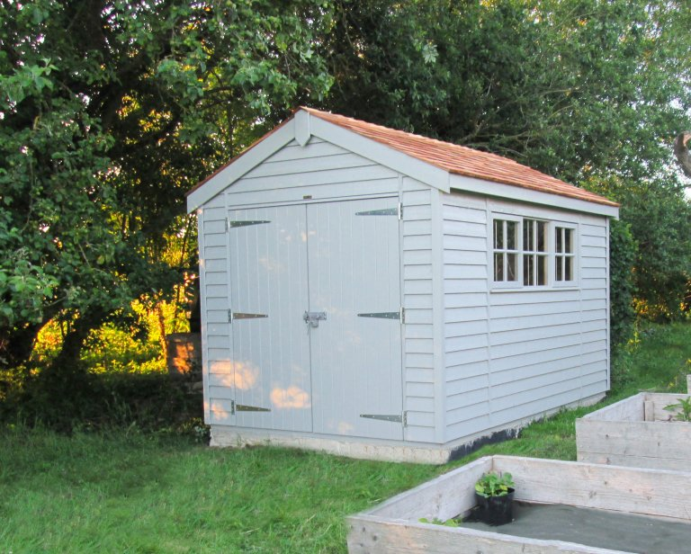 A Superior Shed with double doors, apex roof, weatherboard cladding and Georgian windows