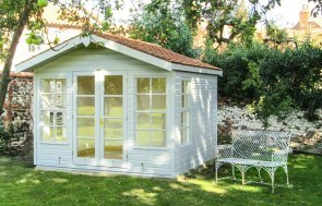 Blakeney Summerhouse in Ivory paint with Georgian windows and cedar shingle roof tiles.