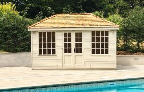 Cely Summerhouse  painted in Valtti Sadstone next to a swimming pool