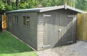 Large timber garage in Sikkens Grey Stain in double doors and single personnel door