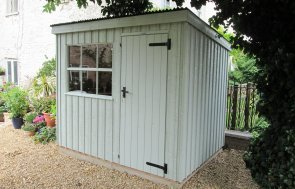 1.8 x 2.4m Oxburgh National Trust Shed painted in Disraeli Green with pent roof design and Georgian window