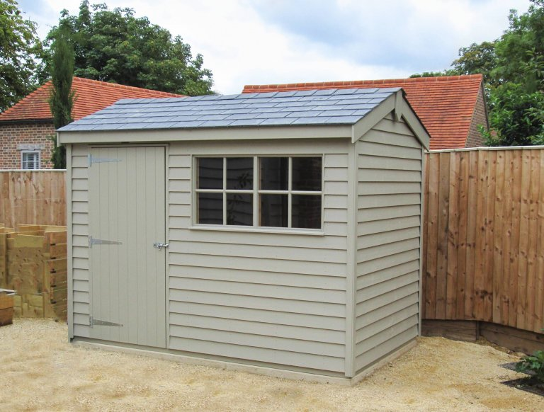 1.8 x 3.0m Superior Shed in Farrow & Ball Light Gray paint, with grey slate effect tiles and weatherboard cladding