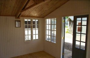 Inside the 4.2 x 4.2m Morston Summerhouse at our Cranleigh show site with shaded Veranda