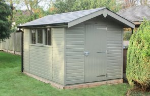 2.4 x 3.6m Superior Shed in Valtti Ash paint with a roof overhang and grey slate effect tiles and black guttering