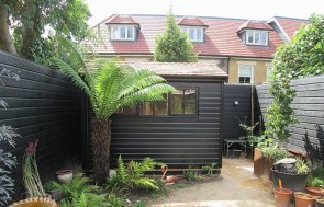 FSC® Certified 1.8 x 3.0m Superior Shed finished in a Black Sikkens wood stain