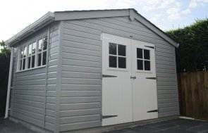 3.6m x 3.0m hand-crafted Superior Shed painted in Pebble with Georgian windows and an apex roof covered in grey slate effect tiles