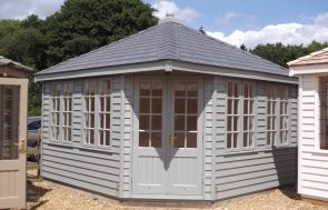 3.6 x 3.6m Weybourne Summerhouse painted in Farrow & Ball's Pigeon with weatherboard cladding