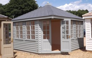 3.6 x 3.6m Weybourne Summerhouse at Narford painted in Farrow & Ball's Pigeon, with Georgian windows and weatherboard cladding
