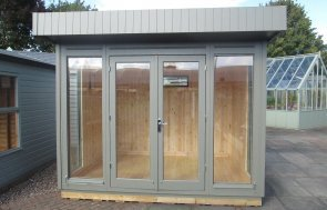 2.4 x 3.0m Salthouse Studio with shiplap cladding painted in Ash at our Nottingham show site