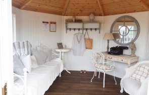 Wiveton Summerhouse interior at Brighton Show Site showcasing painted matchboard lining and Dark Oak Flooring