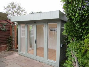 2.4 x 2.9m Salthouse Studio with shiplap cladding painted in the colour Lizard