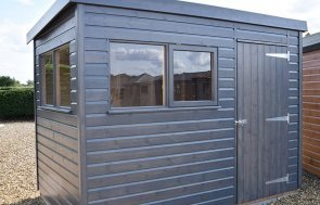 Side view of the 1.8 x 3.0m Superior Shed in Sikkens Grey at our Narford HQ