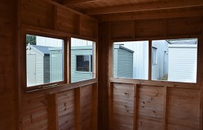 Inside the 1.8 x 3.0m Superior Shed in Sikkens Grey with four windows at our Narford HQ