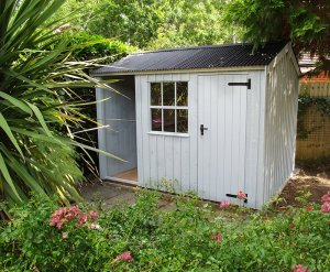 2.4 x 3.0m National Trust Blickling Shed with log store painted in the colour Painters Grey