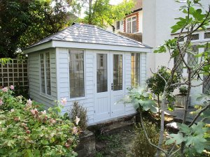 2.4 x 3.0m Cley Summerhouse with rustic-looking Weatherboard Cladding painted in the colour Saltwater