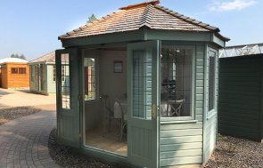 Side view of the 2.4 x 3.0m Lizard-painted Wiveton at Sunningdale with open doors