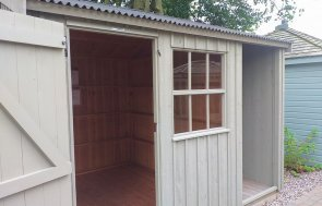 National Trust Blickling Garden Shed with logstore on display at Trentham show site