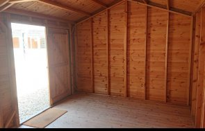 Unlined interior of a  3.0 x 4.8m Superior Shed on display at Newbury show site