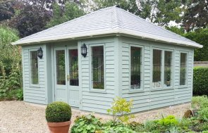 Hipped roof Garden Room with weatherboard cladding and extra windows