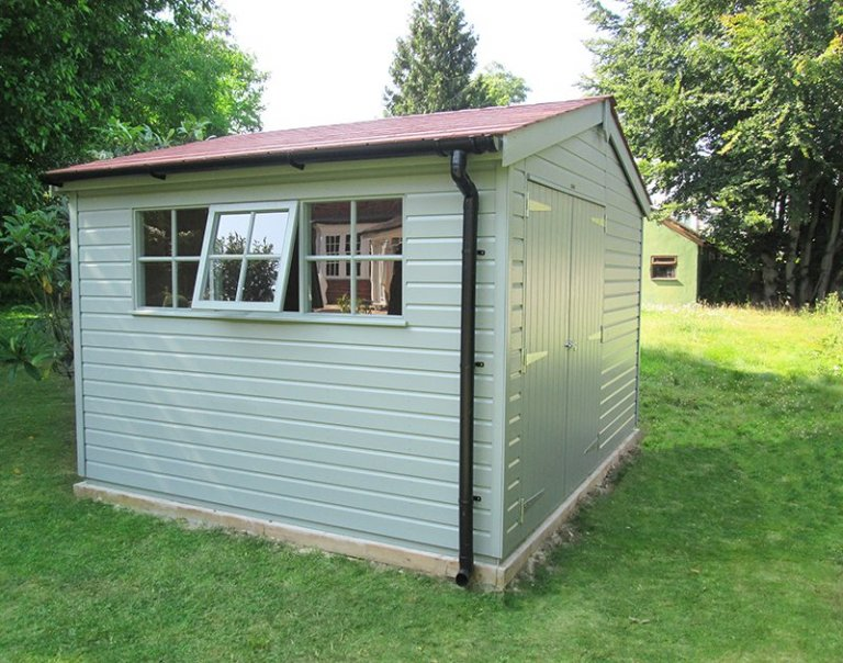 3.6 x 3.0m Superior Shed in Sage with an Apex Roof covered in Terracotta Slate Effect Tiles