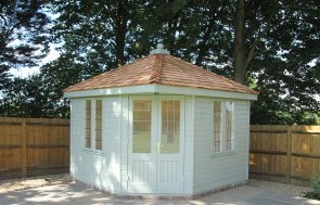 3.0 x 3.0m Weybourne Summerhouse in Sage with a Hipped Roof covered in Cedar Shingles