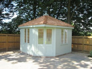 3.0 x 3.0m Weybourne Summerhouse painted in Exterior Sage with a Hipped Roof covered in Cedar Shingles