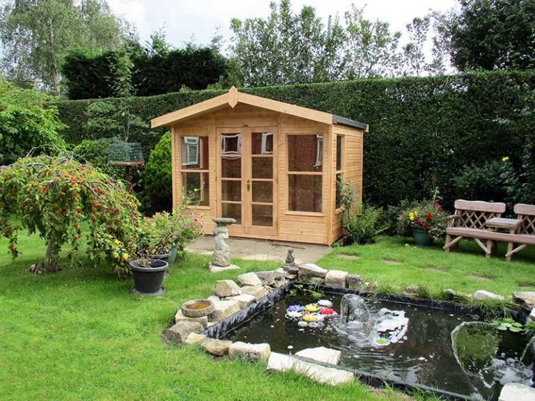3.0 x 2.4m Blakeney Summerhouse in Light Oak with Overhanging Apex Roof covered in Heavy Duty Roofing Felt