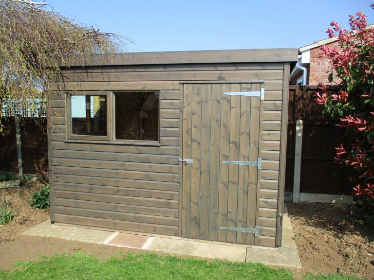 Superior with pent roof in Sikkens Grey with shiplap cladding