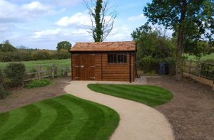 2.4 x 4.2m Superior Shed in Sikkens Walnut with Security Pack and Black Guttering