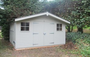 4.2 x 3.6m Superior Shed in Farrow & Ball French Gray with Overhanging Apex Roof and Georgian Windows